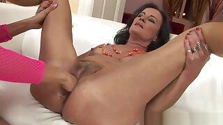 Grandma porn star Sandora uses a huge dildo, then has lesbian sex.
