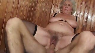 Grandma pornstar Norma bouncing on a young guys hard penis.