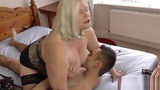 Busty granny enjoying hardcore bondage sex