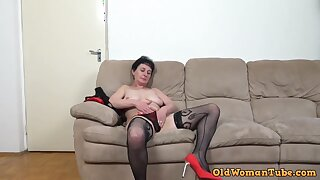 Slim brunette granny in black, fishnet stockings is sucking and riding a rock hard meat stick