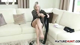 mature granny in pantyhose is teasing with her body